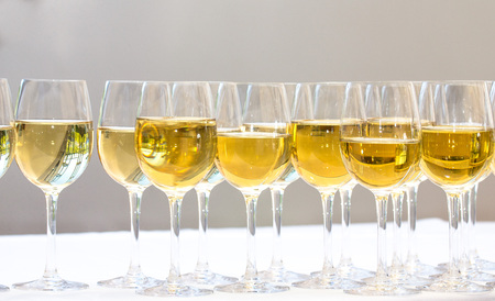 stemware: Stemware of champagne on a white table. Banquet.