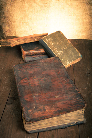 predecessor: old books on a wooden table