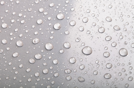 Drops of water on the surface. Shallow depth of field Standard-Bild