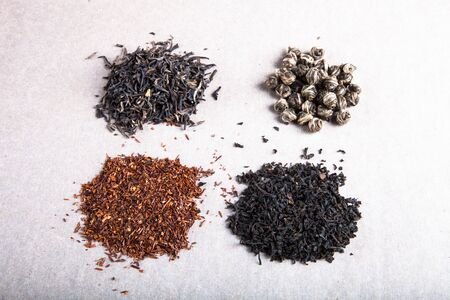 Four kinds of tea on a paper background. photo