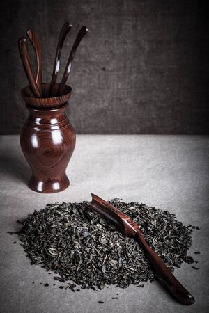 chinese tea ceremony: Green tea and set of wooden tools for chinese tea ceremony. Toned. Stock Photo