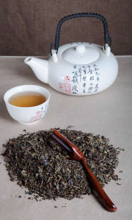 chinese tea ceremony: Green tea, cup and kettle for chinese tea ceremony. Stock Photo