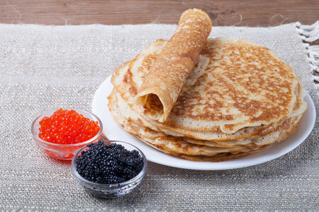 blini: Russian pancakes - blini with red and black caviar. Stock Photo