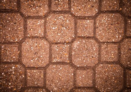 Sidewalk tile made of natural stones. Background. Toned. photo