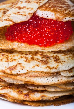blini: Russian pancakes - blini with red caviar. Stock Photo