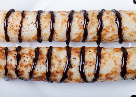 blini: Russian pancakes - blini with chocolate topping.