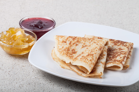 blini: Russian pancakes - blini with jam.