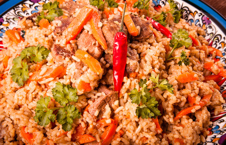 Delicious pilaf on a turkish plate. Close. Toned. Standard-Bild