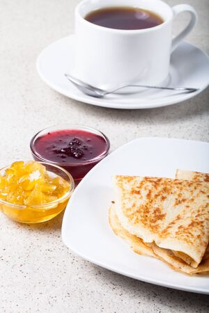blini: Russian pancakes - blini with cup of tea and jam.