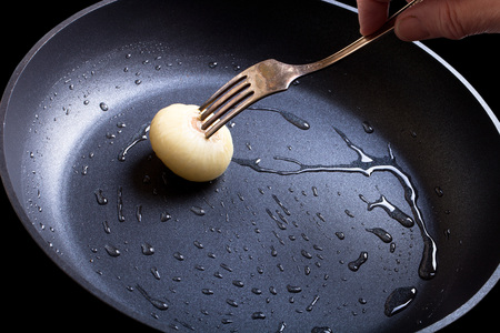 lubrication: Lubrication pan of oil for baking pancakes. Stock Photo