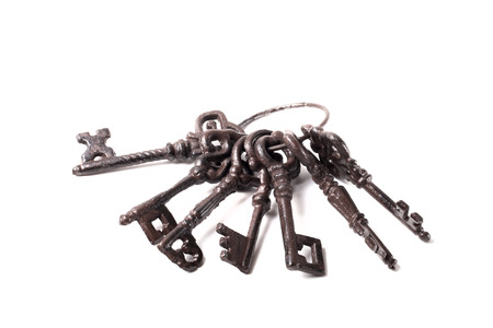Bunch of old keys on a light background.