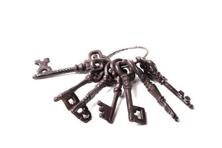Bunch of old keys on a light background.