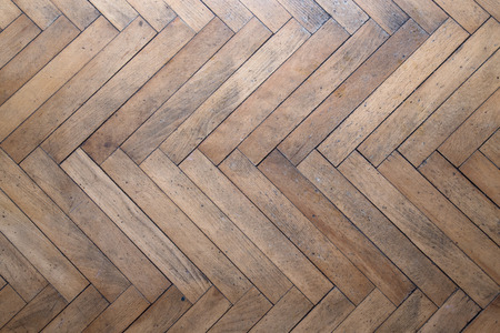 Old light wooden parquet. Background. Toned.