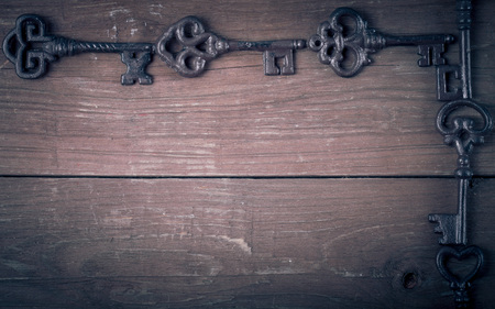 Vintage keys on old wooden boards. Frame or background. Space for text. Toned. photo