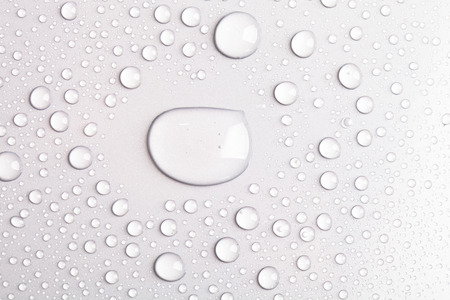 Drops of water on a color background. Gray. Imagens