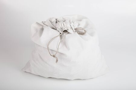 white linen: White linen bag with a rope on a light background. Stock Photo