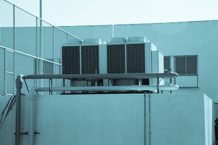 coolant temperature: The air conditioning system installed on the roof of the building. Toned.