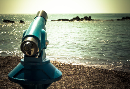 Spyglass on the Mediterranean Sea. Toned. photo