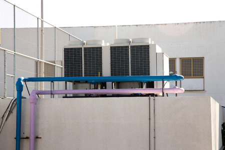 coolant: The air conditioning system installed on the roof of the building.