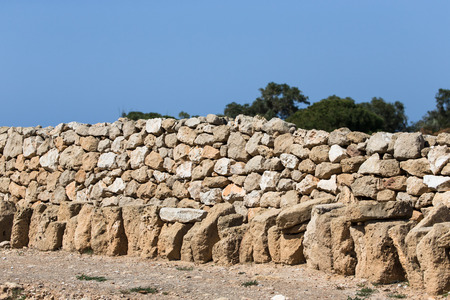 built: fence built of natural stone. Stock Photo