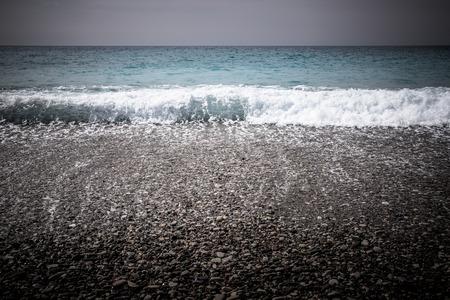 Pebbles Beach and Blue Sea. photo
