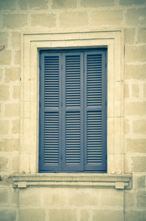 old blue window with shutters closed. photo