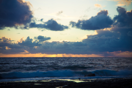 Stormy sunset on the Mediterranean. Clouds and Waves. Toned. photo