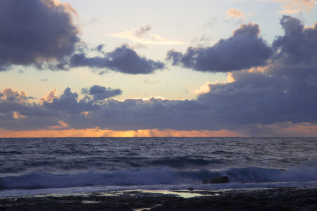 gusty: Stormy sunset on the Mediterranean. Clouds and Waves.