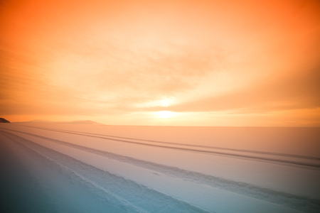 vast: Traces of cars in the vast snowy wilderness. Lake Baikal in winter. Toned.