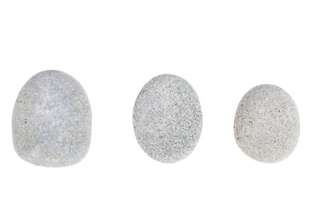 roundish: Three gray round stones is isolated on a white background.