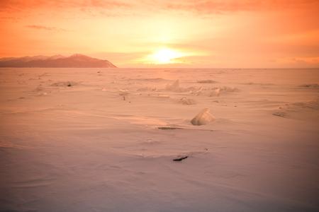 Vast snowy wilderness. Lake Baikal in winter. Toned.