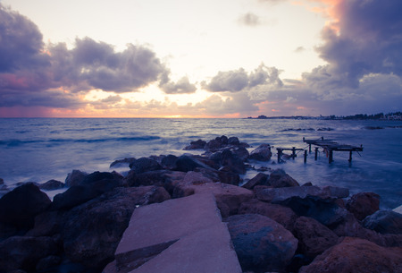 gusty: Stormy sunset on the Mediterranean. Clouds and Waves. Toned.