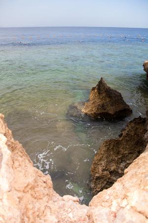 Rocky coast and buoys on the sea in Egypt photo