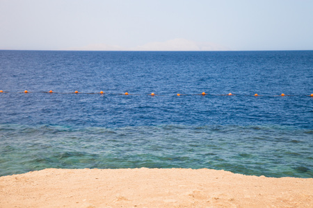 Buoys on the sea and sand. Egypt. Shallow depth of field. photo