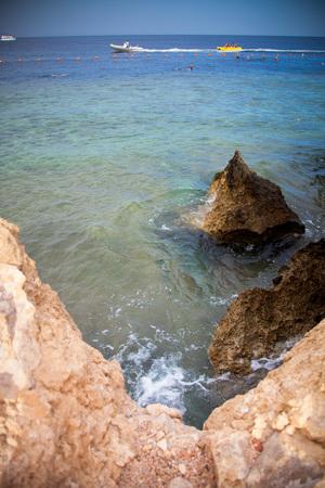 motor boats: Motor boats, buoys on the sea and rocky coast. Egypt. Shallow depth of field. Toned.
