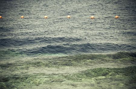 Buoys on the sea. Egypt. Shallow depth of field. Toned. photo