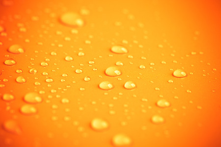 Drops of water on a color background. Toned yellow. Shallow depth of field. background