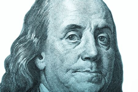 franklin: Portrait of former U.S. President Benjamin Franklin on the hundred dollars isolated on white background. Toned. Stock Photo