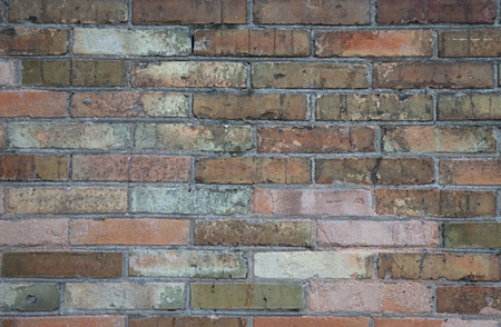 vignetted: red brick wall texture grunge background with vignetted corners to interior design