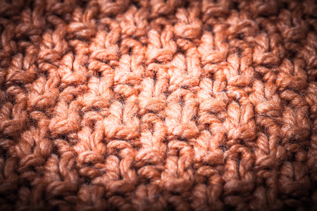 cable stitch: Handmade orange knitting wool pattern background. Toned. Stock Photo
