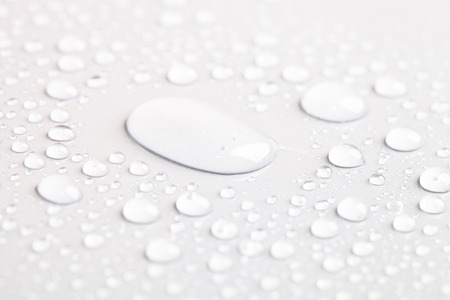 Drops of water on a color background. Toned gray. Shallow depth of field. background