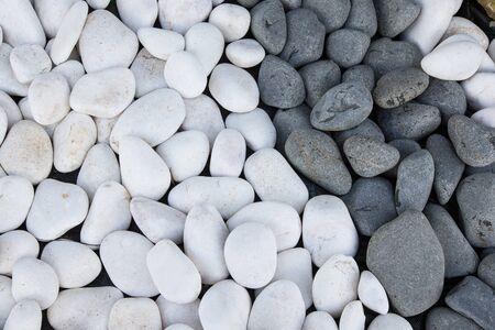 black pebbles: Background of black and white pebbles. Stock Photo