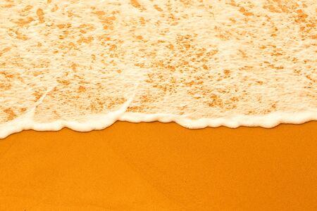 ocea: Sea foam on a sandy beach. Toned.