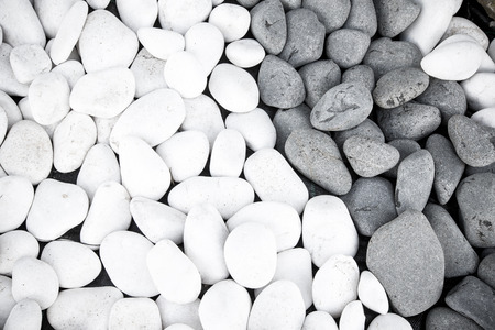 black pebbles: Background of black and white pebbles. Toned.