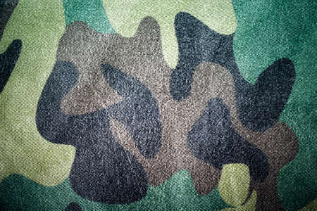 Fabrics with camouflage pattern. Background. Toned. Stock Photo