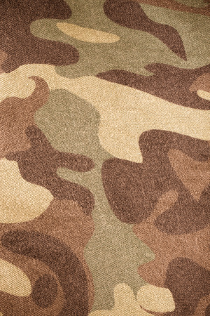 undercover: Fabrics with camouflage pattern. Background. Toned. Stock Photo