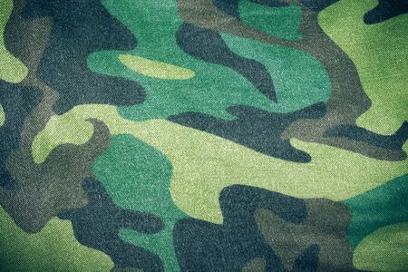 camoflage: Fabrics with camouflage pattern. Background. Toned. Stock Photo
