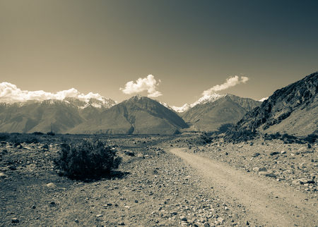 hilly: Hilly landscape in the Fan Mountains. Pamir. Tajikistan. Toned. Stock Photo
