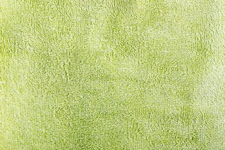 textura: the structure of a green towel for a background