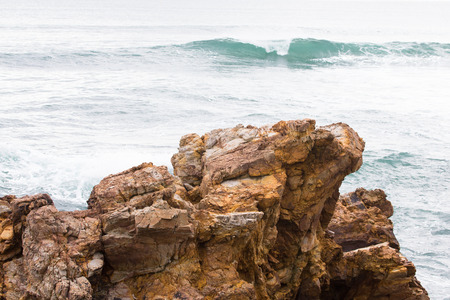 sea cliff: Beautiful rock standing on the beach. Sunset. Stock Photo